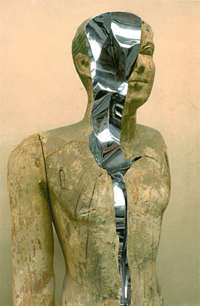 Ancient Egyptian wooden statue cracks open to reveal twisting chrome.