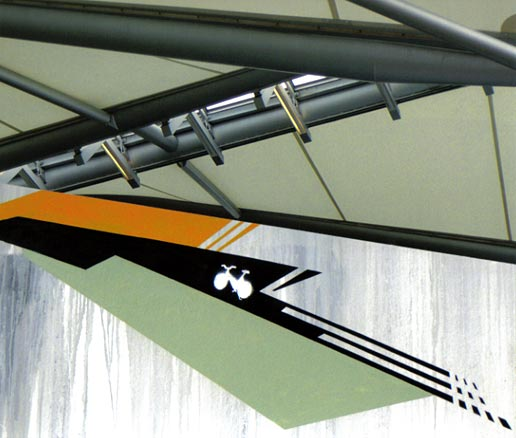 Geometric graffiti, white bike with green, black, yellow and gray drips